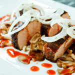 Hawai'i Coffee-rubbed Pork Loin with Sautéed Mushrooms, Red Plum Port Wine Sauce and Shaved Fennel
